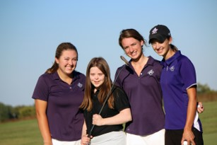 A girls golf team poses together